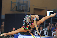 Yana Lukonina of Russia performs split leap with hoop at 2011 Holon Grand Prix, Israel on March 4, 2011.  (Photo by Tom Theobald)    ..