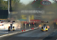Sep 3, 2016; Clermont, IN, USA; NHRA top fuel driver Leah Pritchett (left) races alongside Shawn Langdon during qualifying for the US Nationals at Lucas Oil Raceway. Mandatory Credit: Mark J. Rebilas-USA TODAY Sports