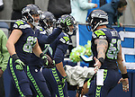 Seattle Seahawks center Justin Britt (68) runs up to congradulate running back C.J. Prosise , center, after he rushed for a 73-yard touchdown against the Philadelphia Eagles, at CenturyLink Field in Seattle, Washington on November 20, 2016.  Seahawks beat the Eagles 26-15.  ©2016. Jim Bryant Photo. All Rights Reserved.