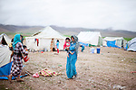 ARBAT, IRAQ: Women look after children in a refugee camp on the outskirts of Arbat in the semi autonomous region of Iraqi Kurdistan. ..Refugees from Syria, most of whom are Kurds, have been arriving at camps in Kurdistan trying to escape the continuing conflict.  Arbat is located approximately 20 kilometres away from Sulaimaniyah...Photo by Ali Arkady/Metrography.
