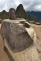 """Intiwatana astronomical observatory. Machu Picchu, the ancient """"lost city of the Incas"""", 1400 CA, 2400 meters. Discovered by Hiram Bingham in 1911. One of Peru's top tourist destinations. Huayanapichu (young mountain) in the distance."""