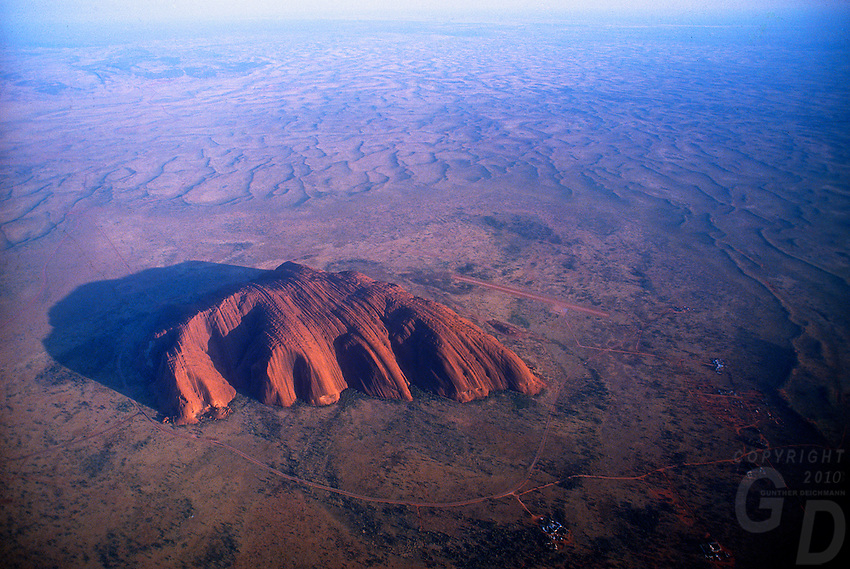 Aerial View of AyersRock and surrounding Sand dunes