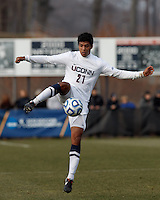University of Connecticut forward Nicholas Zuniga (21) collects a pass. .NCAA Tournament. Creighton University (blue) defeated University of Connecticut (white), 1-0, at Morrone Stadium at University of Connecticut on December 2, 2012.