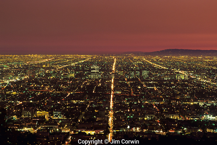 Row after row of city lights retreating into the distance from Griffith Park, downtown Los angeles, California USA