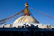 Tibetan and local Nepalese Buddhists pilgrims circle around the dome in the holy site of Boudhanath in Kathmandu, Nepal. Photo: Sanjit Das/Panos