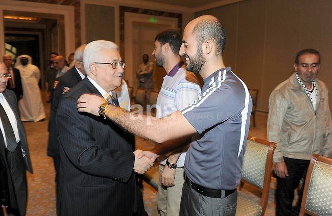 Palestinian President Mahmoud Abbas meets with the freed Palestinian prisoners who released to Qatar in Doha October 31, 2011. Photo by Thaer Ganaim
