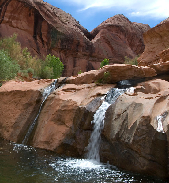 This 15 foot waterfall at the mouth of Fortymile Gulch has been revealed by the lowering waters of Lake Powell. <br /> Glen Canyon National Recreation Area, Utah