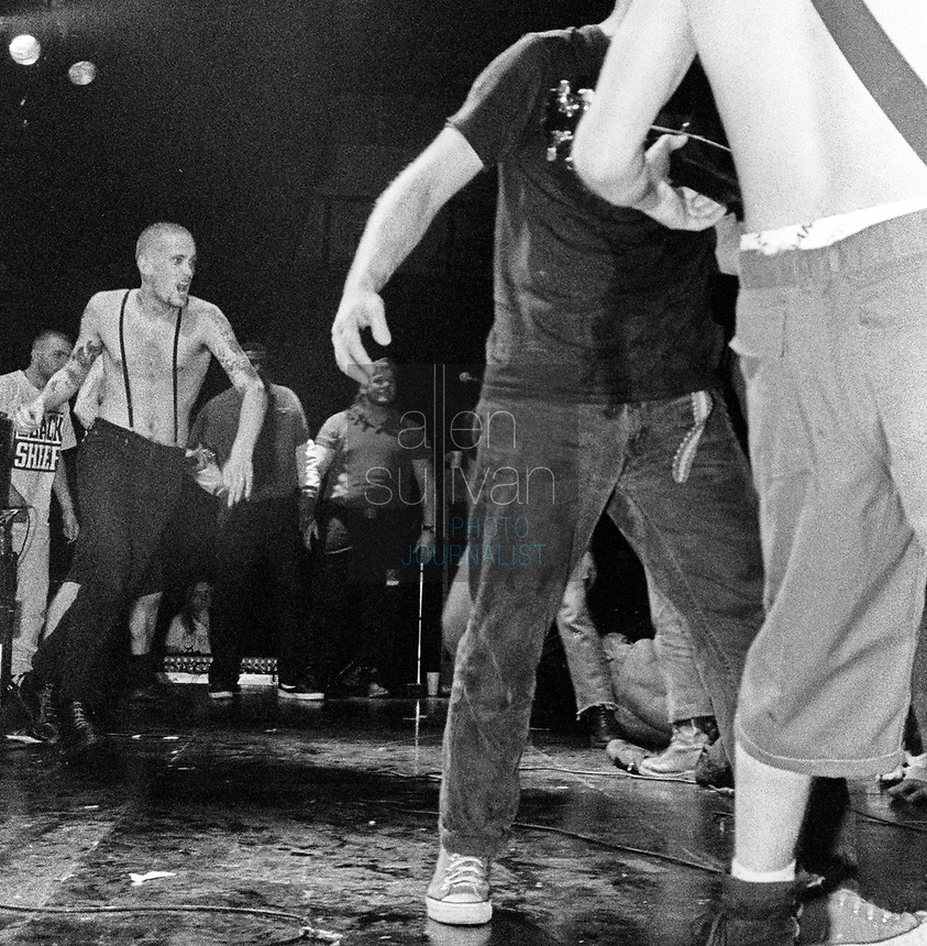 A skinhead fan runs to stage dive as Jimmy Gestapo and Murphy's Law perform in Atlanta, Georgia in the early 1990s.