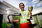 Thirteen-year-old Benafscha Sadiqi poses with the trophy she won in her first bicycle race in Kabul, Afghanistan. She's the daughter of Abdul Sadiqi, the president and founder of the Afghan Cycling Federation