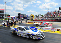 May 6, 2012; Commerce, GA, USA: NHRA  pro stock driver Allen Johnson (near lane) races alongside Greg Anderson during the Southern Nationals at Atlanta Dragway. Mandatory Credit: Mark J. Rebilas-