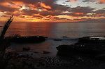 Dusk over the Atlantic with the island of La Gomera in the background, Playa de las Americas, Tenerife, Canary Islands.