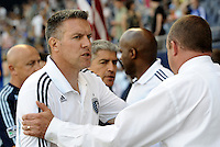 Sporting KC head coach Peter Vermes shakes hands with Vancouver Whitecaps head coach Tom Soehn prior to the game... Sporting KC defeated Vancouver Whitecaps 2-1 at LIVESTRONG Sporting Park, Kansas City, Kanas.