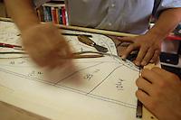 Artigiani a San Lorenzo , quartiere storico di Roma.<br /> Craftsmen in San Lorenzo, historic district of Rome. <br /> Aldo Rizzuti mentre prepara le sue vetrate artistiche, nella sua bottega.<br /> Aldo Rizzuti while preparing its artistic stained glass, in his workshop.