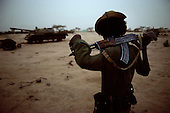 Afabet, Eritrea.June 7, 1988..An Eritrean People's Liberation Front (EPLF) fighter watches over weapons captured from the Ethiopian army. The EPLF is fighting for  independence against the Ethiopian Government lead by Mengistu Haile Mariam the most prominent officer of the Derg, the military junta.......