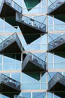 Glass balcony modern architecture new high rise homes development Orestads Boulevard in Orestad City area, Copenhagen, Denmark