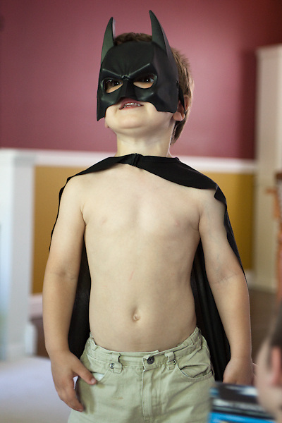 My younger son just after he opened a Batman mask and cape from my mom and sister for his fourth birthday. He wore them for the next two days.