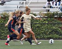 Boston College midfielder Kristen Mewis (19) brings the ball forward. Pepperdine University defeated Boston College,1-0, at Soldiers Field Soccer Stadium, on September 29, 2012.