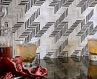 Houndstooth, a hand cut jewel glass mosaic shown in Jasper and Alabaster, is part of the Houndstooth Collection by Sara Baldwin for New Ravenna Mosaics.