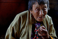 An old Bhutanese lady prays with her praying beads. Thimpu. Arindam Mukherjee..