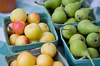 Fresh, local organic and biodynamically grown yellow plums and Croatian pears grown by Laura Sabourin's Feast of Fields and on sale at Toronto's Dufferin Grove organic farmers market.