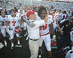 Jacksonville State Head Coach Jack Crowe celebrates with Jacksonville State defensive tackle Tim McGee (99)  at Vaught-Hemingway Stadium in Oxford, Miss. on Saturday, September 4, 2010. Jacksonville State won 49-48 in double overtime.