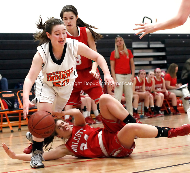 Watertown, CT- 14 February 2013-021413CM09- Watertown's Jamie Zoldy, left, takes the ball towards the hoop after colliding with Wolcott's Madison Hanlon during their NVL matchup Thursday night in Watertown.   Christopher Massa Republican-American