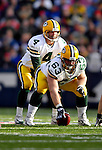 5 November 2006: Green Bay Packers quarterback Brett Favre (4) calls out signals as center Scott Wells (63) prepares to snap the ball against the Buffalo Bills at Ralph Wilson Stadium in Orchard Park, NY. The Bills defeated the Packers 24-10. Mandatory Photo Credit: Ed Wolfstein Photo.<br />