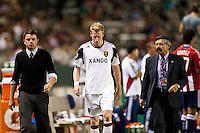 CARSON, CA – August 27, 2011: Real Salt Lake defender Nat Borchers being led off the field after receiving a red card during the match between Chivas USA and Real Salt Lake at the Home Depot Center in Carson, California. Final score Chivas USA 0, Real Salt Lake 1.