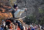 "Dressed in ornate period costume, a member of the Toyama-ryu ""yabusame"" horseback archery group fires an arrow at a target during a yabusame ritual in Machida, western Tokyo, Japan on Nov. 28 2010. During the late Heian era (794 to 1185) and Kamakura era (1185-1333) such archery was the domain of high-ranked samurai and was used as a military training exercise to keep samurai prepared for war. .Photographer: Robert Gilhooly"