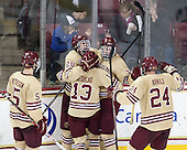 Michael Matheson (BC - 5), Scott Savage (BC - 28), Johnny Gaudreau (BC - 13), Kevin Hayes (BC - 12) and Bill Arnold (BC - 24) celebrate Hayes' goal. - The Boston College Eagles defeated the visiting University of Notre Dame Fighting Irish 4-2 to tie their Hockey East quarterfinal matchup at one game each on Saturday, March 15, 2014, at Kelley Rink in Conte Forum in Chestnut Hill, Massachusetts.