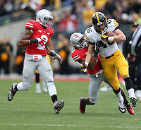 Ohio State's Bradley Roby pulls down Iowa's George Kittle during first period.  Jabin Botsford/Dispatch