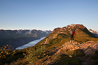 Stephanie Haynes hiking on the Alpine Ridge trail in Kachemak Bay State Park, near Homer, Alaska. Grewingk Glacier is visible in the valley below.