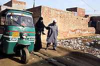 Now nearly blind, Saira is helped into her fathers Rickshaw from their home in a suburb of Lahore. He will drive her to the beauty palour for her work. He spends 4 hrs a day driving her to work, returning home, then again picking her up in the evening. 21 yr old Saira Liaqat's face was destroyed in 2003 by her soon to be husband who threw acid over her. Her punishment was for refusing to leave her parents home and go with him to his house..Saira's face has been partially reconstructed by doctors funded by a Lahore based charity called Smile Again. Each year across pakistan thousands of women have acid thrown over them by men.