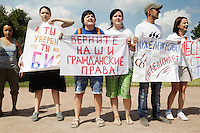 LGBT activists (lesbian, gay, bisexual, and transgender) at a gay-pride rally in central St. Peterburg. The rally was attacked by anti-gay ultra-nationalists and the activist were arrested by the police. On 30 June 2013, Russian President Vladimir Putin signed into law an ambiguous bill banning the 'propaganda of nontraditional sexual relations to minors'. The law met with widespread condemnation from human rights and LGBT groups. The law has since been used to ban Gay Pride Rallies in the city. (MANDATORY CREDIT   photo: Mads Nissen/Panos Pictures /Felix Features)