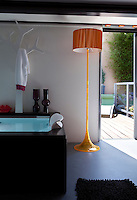 A sliding glass door opens onto the inner courtyard from the master bathroom