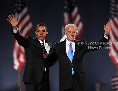 Chicago, IL - November 4, 2008 -- United States President-elect Barak Obama and Vice President-elect Joseph Biden wave to supporters in Lower Hutchinson Field, Grant Park, Chicago, Illinois after their election on Tuesday, November 4, 2008..Credit: Ron Sachs / CNP.(Restriction: No New York Metro or other Newspapers within a 75 mile radius of New York City)