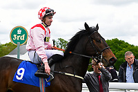 Winner of The Simon & Nerys Dutfield Memorial Novice Stakes,Youkan ridden by Martin Lane and trained by Stuart Kittowin the winners enclosure during Afternoon Racing at Salisbury Racecourse on 18th May 2017