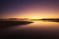 Sunrise brings a calming glow to South Aliomanu Beach, East Kaua'i.