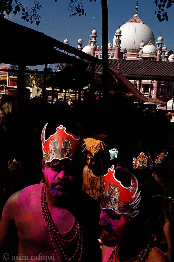 At the Sabarimala pilgrimage, Hindu pilgrims exit Vavar's mosque after a circumnavigation and head towards the shrine.