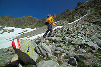 Verwall Gruppe, Ischgl, Austria, July 2004. Mountain guide Gottfried Narr leads us from Ischgl over the Doppelsee scharte pass to the hut. Trekking from hut to hut in the Verwall Gruppe is a strenuous adventure, however no knowledge of technical mountaineering is necessary. Photo by Frits Meyst/Adventure4ever.com