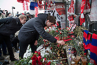 Moscow, Russia, 15/01/2011..People lay flowers and light candles during a rally at the bus stop where Spartak soccer fan Yegor Sviridov was killed in a street fight with a group of men from the southern Caucasus, leading to a nationalist backlash that has spilled into racist violence on the streets of Moscow and other Russian cities. The rally on the 40th day after Sviridov's death was attended by a mixture of local people, football fans and Russian nationalists.