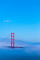 Golden Gate Bridge in fog with blue sky from Lincoln Park San Fransisco