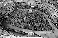 &copy; Francesco Cito / Panos Pictures..Siena, Tuscany, Italy. The Palio. ..An aerial view of the Piazza del Campo on the day of the race...Twice each summer, the square in the medieval Tuscan town of Siena is transformed into a dirt racetrack for Il Palio, the most passionately contested horse race in the world. The race, which lasts just 90 seconds, has become intrinsic to the town's heritage since it was first run in 1597...