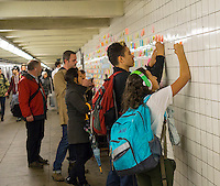 "Thousands of travelers write their thoughts about the results of the presidential election on post-it notes as part of the ""Subway Therapy"" project by Matthew Chavez in the subway in New York, seen on Tuesday, November 15, 2016. Chavez started the project yo enable New Yorkers to vent their emotions on the election of Donald Trump. Many wrote angry messages and some wrote messages of hope and some now felt they were not alone and part of a community. (© Richard B. Levine)"