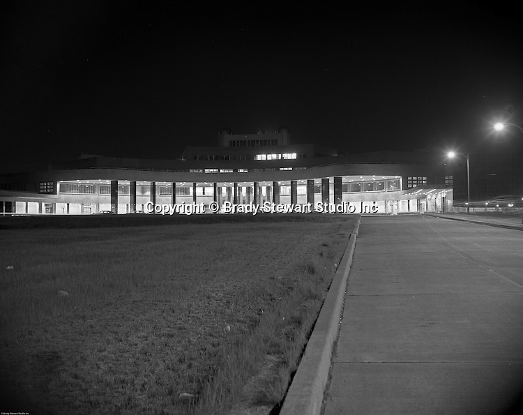 Pittsburgh PA: View of the main entrance of the Greater Pittsburgh airport at night in 1952. In 1944, Allegheny County officials proposed to expand the military airport with the addition of a commercial passenger terminal in order to relieve the Allegheny County Airport, which was built in 1926 and whose capacity was quickly becoming insufficient to support the growing demand for air travel.  The new airport, christened as Greater Pittsburgh Airport opened on May 31, 1952. The first flight occurred on June 3, 1952.