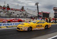 Feb 10, 2017; Pomona, CA, USA; NHRA pro stock driver Jeg Coughlin Jr (near) races alongside teammate Erica Enders-Stevens during qualifying for the Winternationals at Auto Club Raceway at Pomona. Mandatory Credit: Mark J. Rebilas-USA TODAY Sports