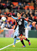United's Chris Pontius tries to keep the ball inbound against Sporting KC's Kei Kamara. Sporting Kansas City defeated D.C. United 1-0 during an MLS home opener at the RFK Stadium in Washington, D.C. on Saturday, March 10, 2012. Alan P. Santos/DC Sports Box
