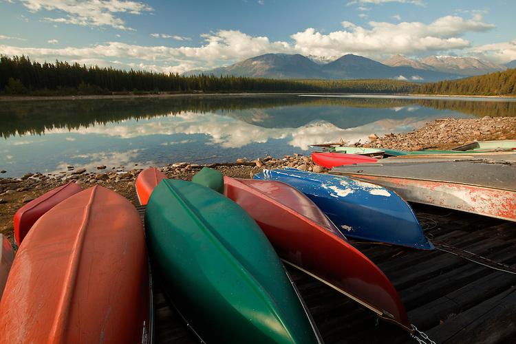 Kayaks rest along the shoreline of Patricia Lake in Jasper National Park, Alberta, Canada