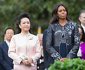 First Lady Michelle Obama and Madame Peng Liyuan of China listen during an official State Visit on the South Lawn of the White House in Washington, DC on Friday, September 25, 2015.<br /> Credit: Chris Kleponis / Pool via CNP