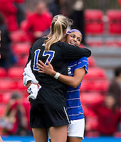 Kim DeCesare (19) of Duke celebrates the win with Meghan Thomas (17) at Ludwig Field on the campus of the University of Maryland in College Park, MD. DC. Duke defeated Maryland, 2-1.